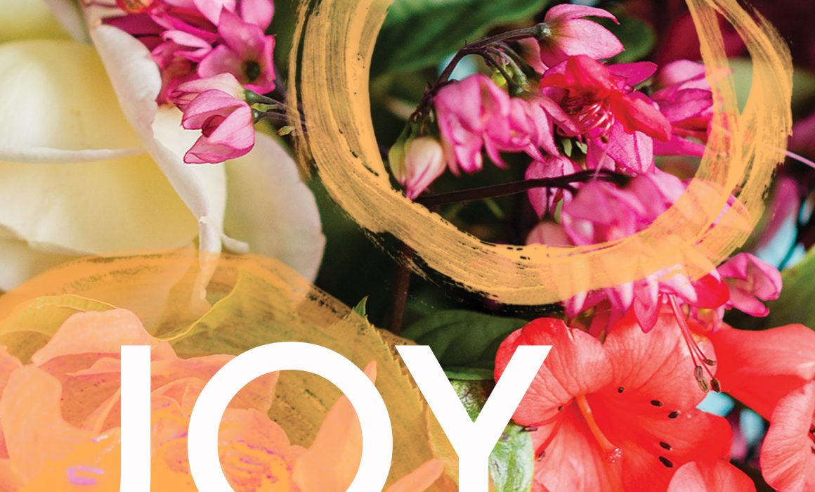 Colourful flowers with 'Joy' is bold white writing